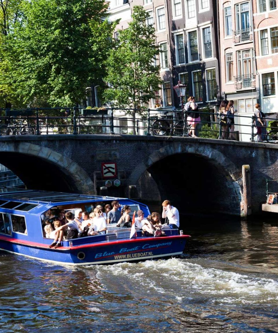 canal cruise blue boat